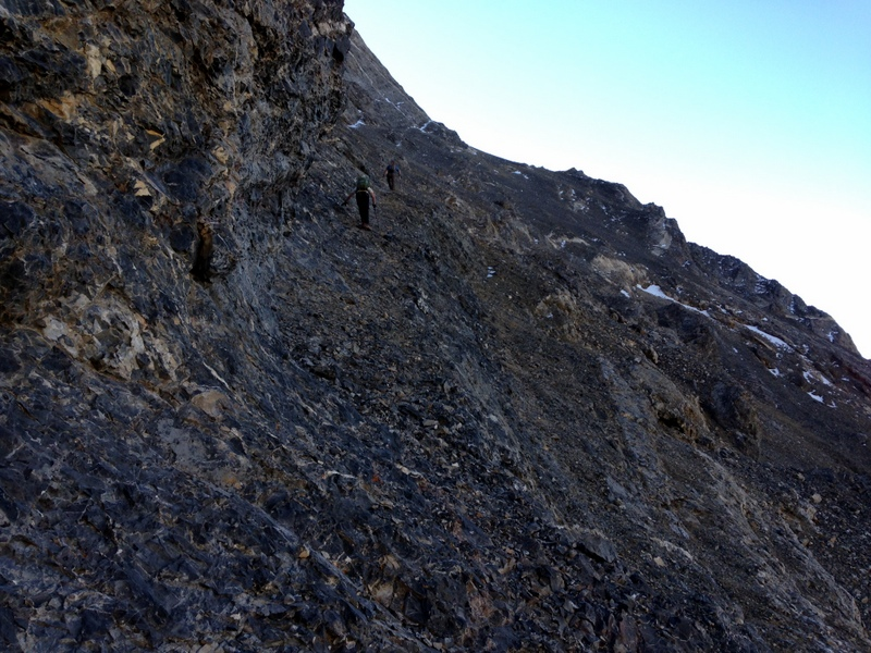 The right hand route climbs talus to the snow patch shown in the prior photo and then climbs this ledge.