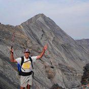 Dennis near the summit of No Regret Peak. Mount Church in the background.