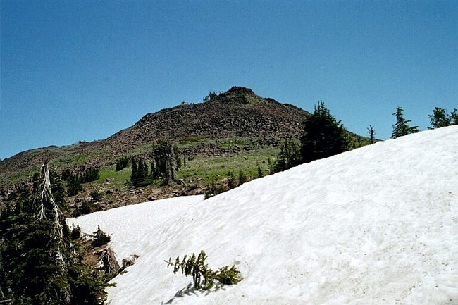 The approach to the summit of Pollock Mountain. The trail ascends the west (left) side or one can scramble up the boulders on the south end of the ridge. July 2004. Mike Hays Photo