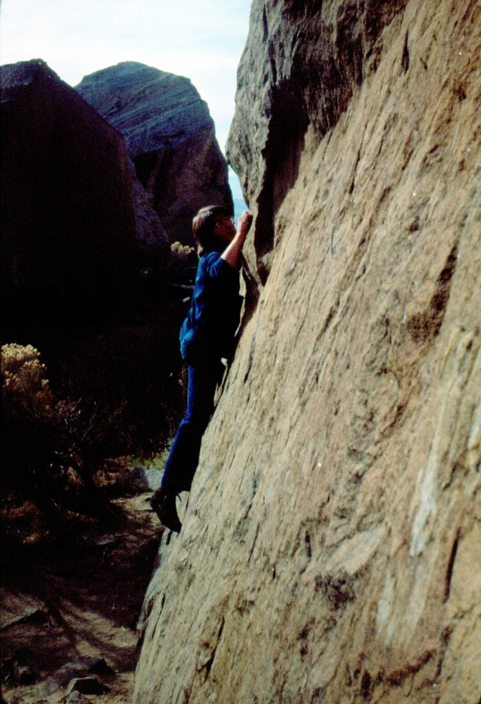 "Bob working a classic mid-cliff slab in blue jeans and Fabiano Directisma ""blue boots"" as we called them. They were totally rigid from heel to toe making them terrible for walking, but they worked perfectly on the tiny nicks and chips in the quarried rock. Mike Weber Photo"