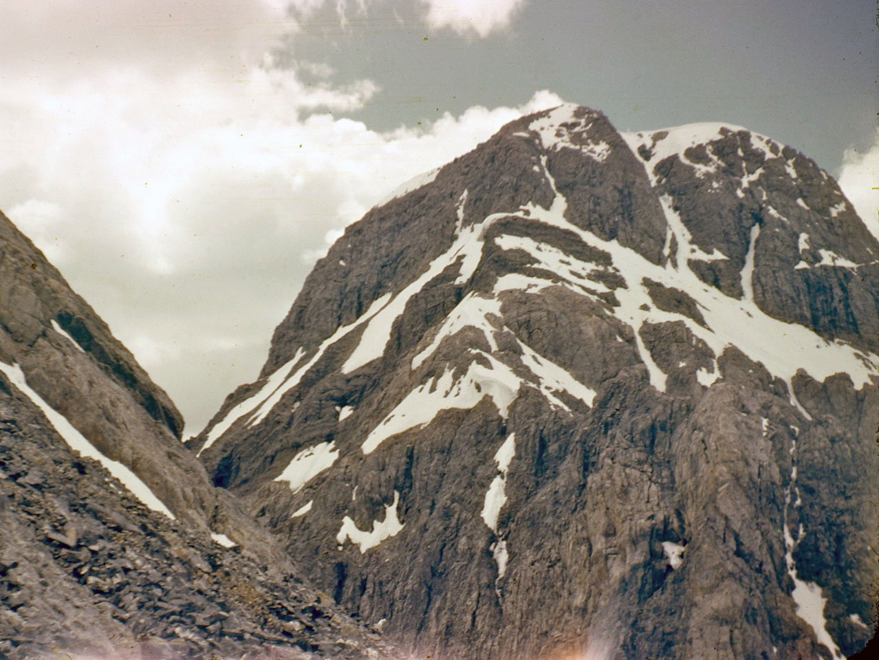 Looking up at the Northeast ridge and summit block (far left). Photo - Lyman Dye