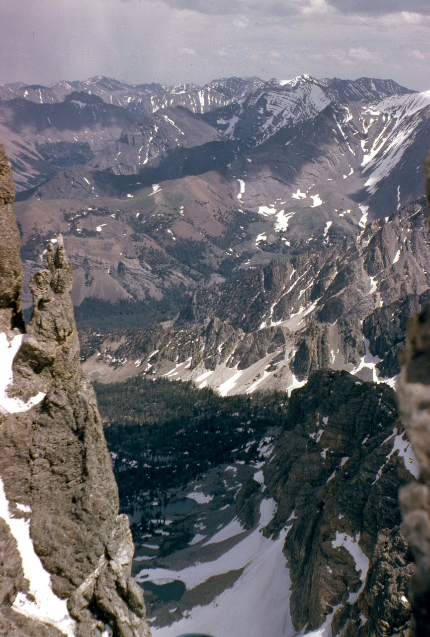 Looking down the col into the East Face cirque. This is where the East Face route joins the Northeast ridge. Photo - Lyman Dye