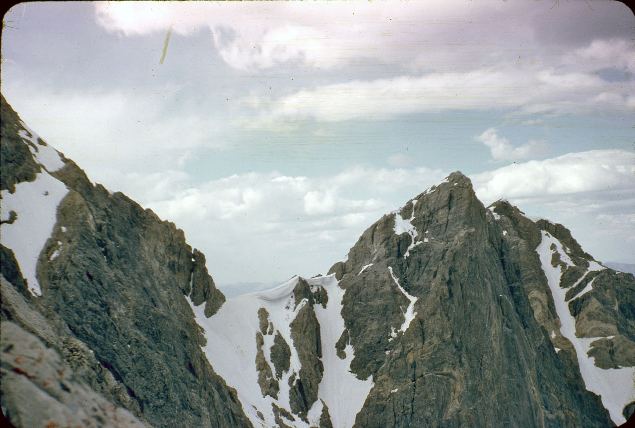 """Looking across the East Face (left-to-right) at the Northeast ridge, the col and what we call the """"Super Buttress."""" Photo - Lyman Dye"""