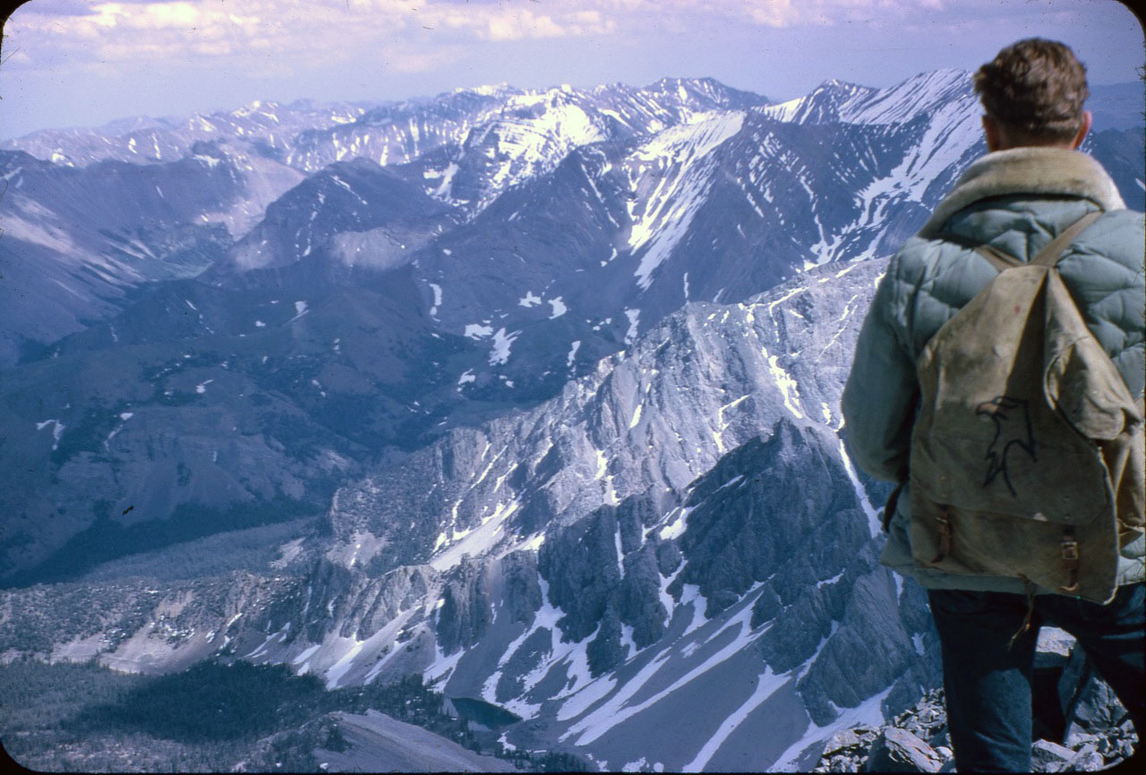 Wayne looking into the East Face cirque from the summit of Mount Borah. Photo - Lyman Dye
