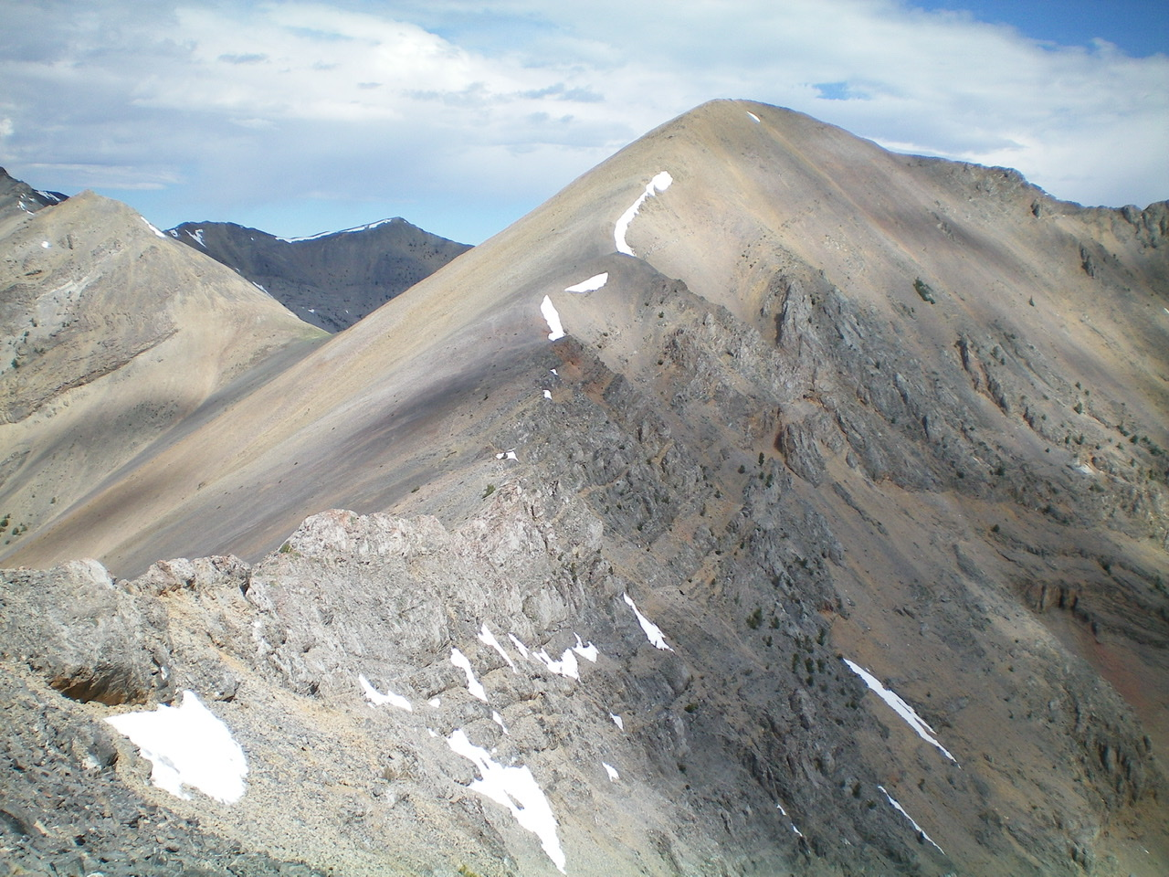 The Southeast Ridge of the Knoll (summit is just right of center) as viewed from low on the Northwest Ridge of Umpleby Peak. Livingston Douglas Photo
