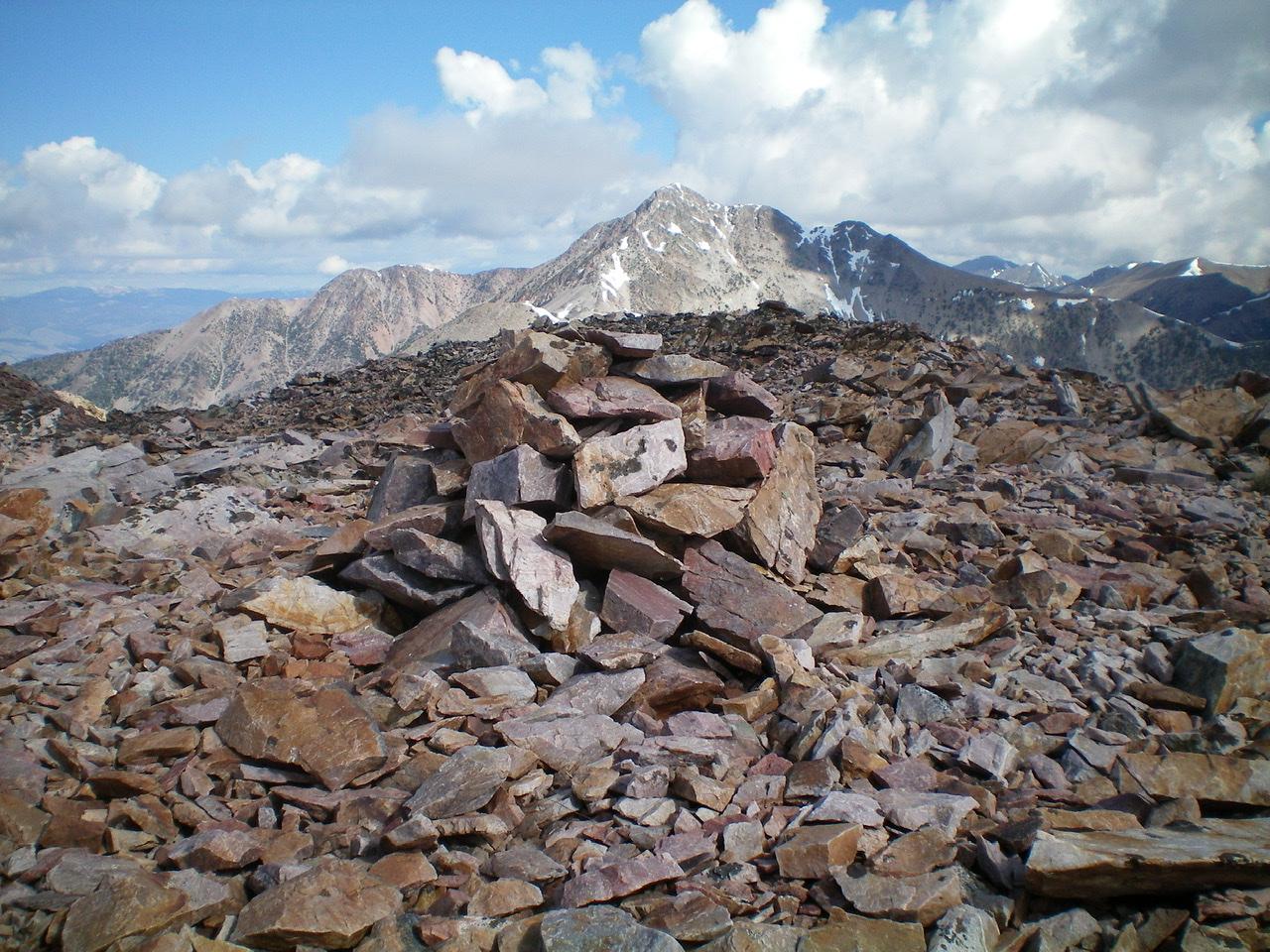 The rebuilt summit cairn atop Peak 10349. Livingston Douglas