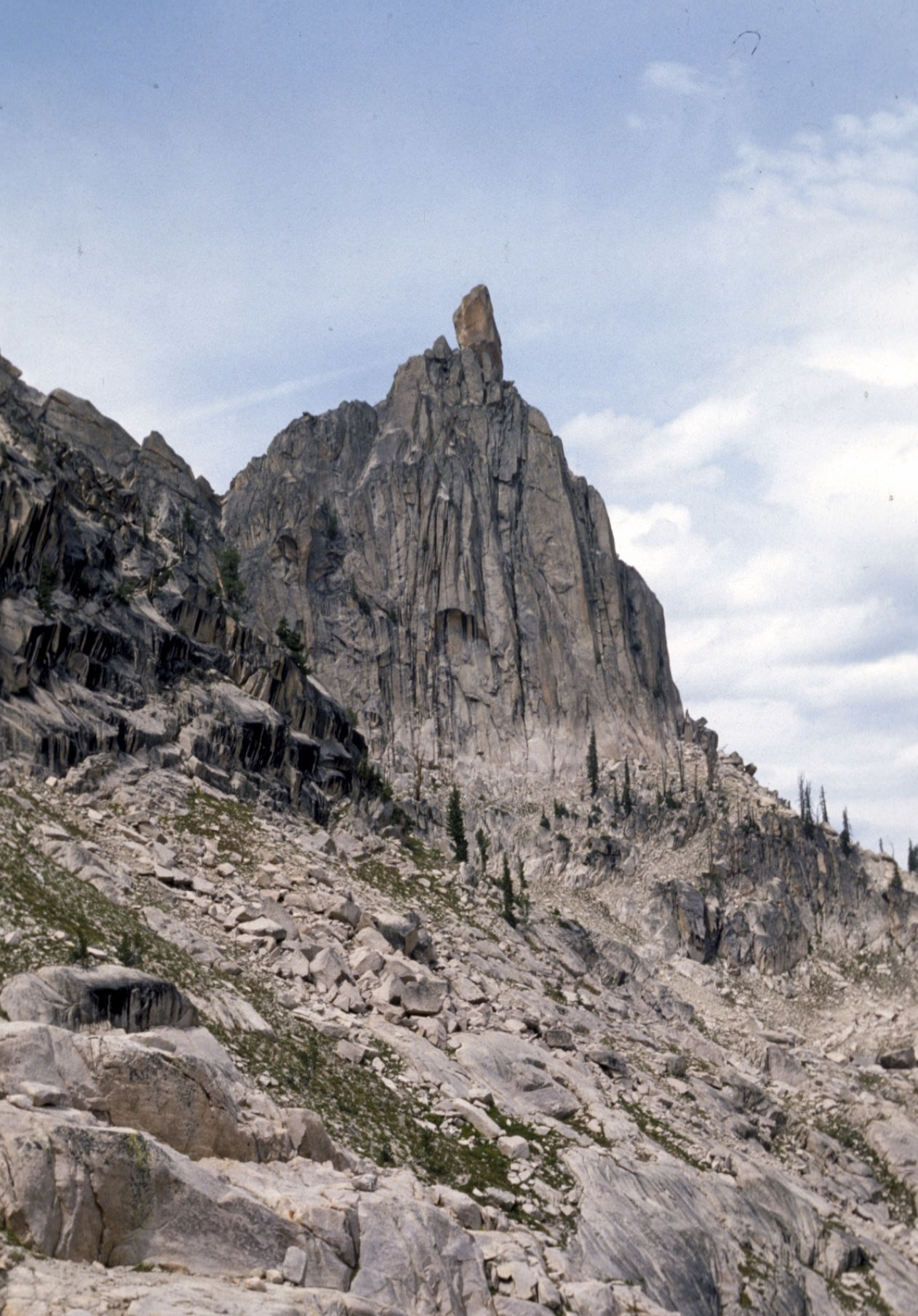 Southeast side of Big Baron Spire. Becky route traverses to just below the notch from cliffs on left of photo, then stays near ridgeline to the summit block. Ray Brooks Photo