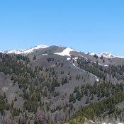 Trouble Peak viewed from Peak 8100. South Dollarhide Peak is the snow covered summit behind Trouble Peak.