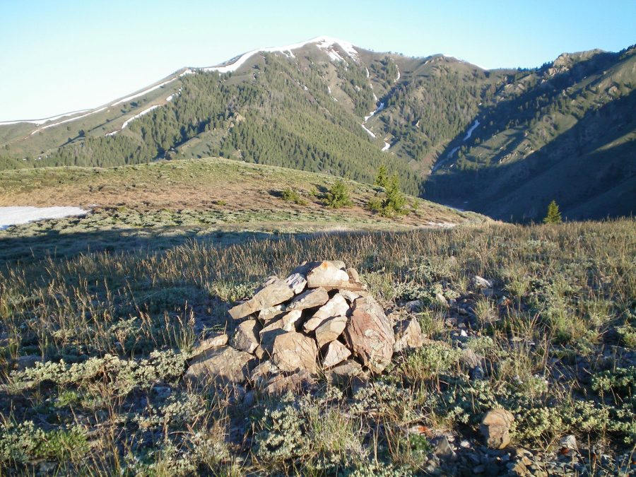 The summit cairn atop Peak 7536 with snow-clad Kelly Mountain (8,826 feet) in the distance. Livingston Douglas Photo