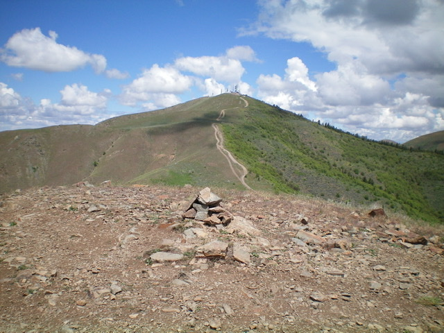The summit cairn atop Peak 6361 with Chinese Peak in the background. Livingston Douglas Photo