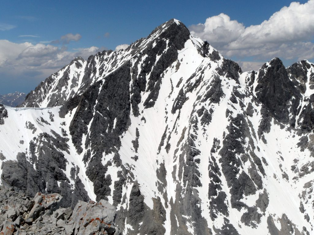 The South Face of Mount Borah. Four of Mount Borah's major ridges are visible in this picture. From upper left to right - Northwest Ridge, Southwest Ridge, East Ridge, and the Northeast Ridge. Photo by Wes Collins