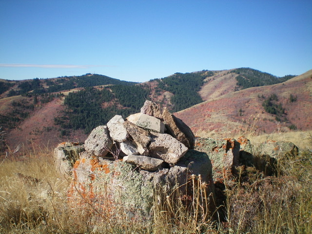 The newly-built summit cairn atop Peak 6620, looking west. Livingston Douglas Photo