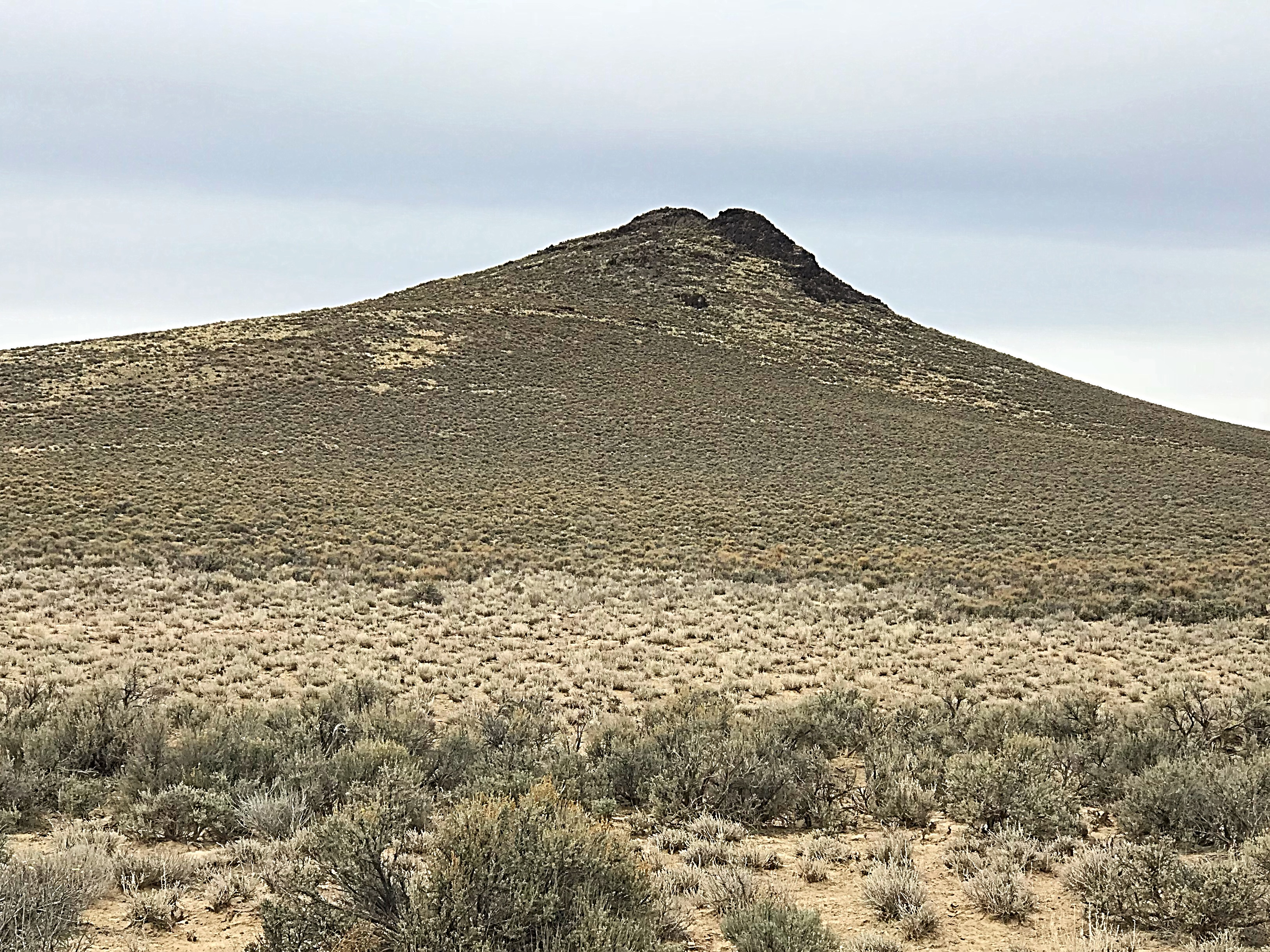 Peak 5565 resembles a volcanic cone but is simply a remnant of a sedimentary uplift.