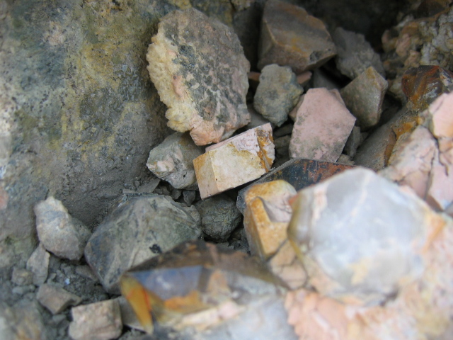 "Large broken fragments of quartz and feldspar crystals in the destroyed ""crystal cave."