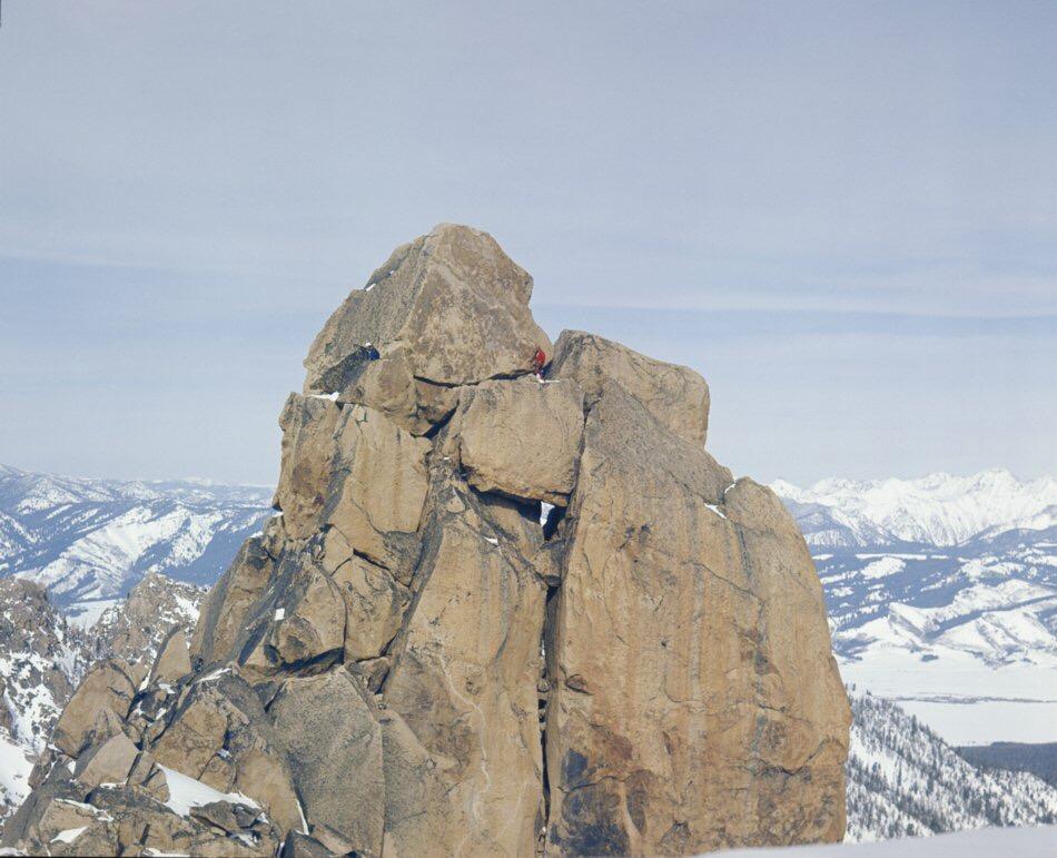 Looks like Gordon belaying the next climber up, while Harry pokes around.