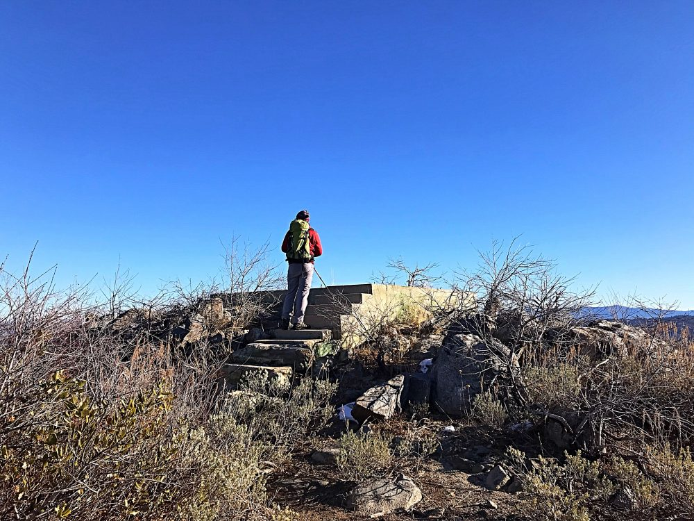 John Platt on the old lookout steps. The highest point on the mountain is actually a granite outcrop located just west of the lookout foundation.