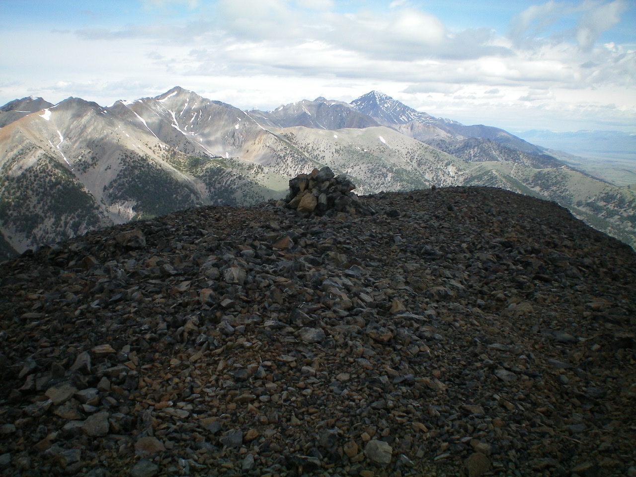 The gentle summit of White Bird Peak and its large summit cairn on a stormy summer morning. Livingston Douglas Photo