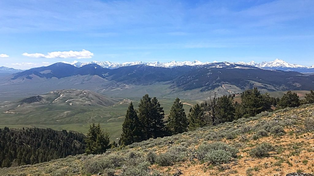 The Donkey Hills with the Lost River Range in the background as viewed from the Lemhi Range. Donkey Benchmark is the peak with snow on the rigjt side of the photo.