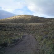 Peak 5380 (dead center) as viewed from the base of the northeast gully near Arbon Valley Road. The summit high point sits behind the hump in the photo. Livingston Douglas Photo