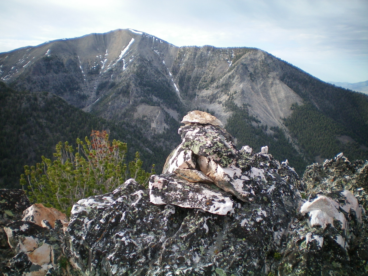 The summit cairn atop the highest rocky outcrop atop Peak 9634. Peak 10954 is in the background. Livingston Douglas Photo