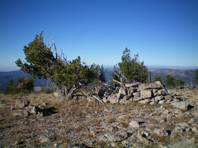 The boundary post and cairn atop Slide Mountain. Livingston Douglas Photo