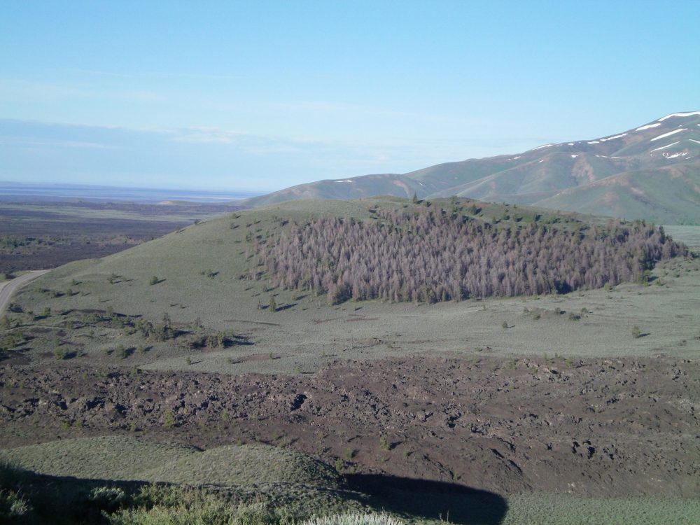 Grassy Cone as viewed from the summit of Sunset Cone. US-20 is on the left side of the photo. Livingston Douglas Photo