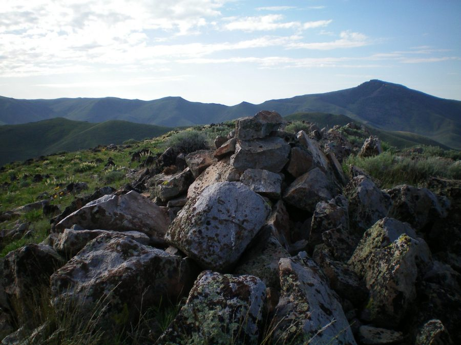 The summit cairn atop rocky Peak 6390 with Pine Mountain in the background (right of center). Livingston Douglas Photo