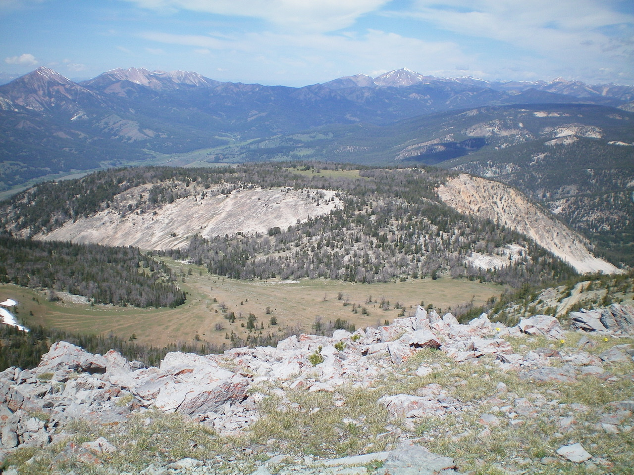 The Southwest Ridge as viewed from the upper reaches of the peak. The ridge crosses the meadow, follows a forested section (right of center), and then bends L to follow a ridge crest to the valley floor at Sawmill Canyon Road. Livingston Douglas Photo
