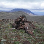 The summit cairn atop Peak 8297 South with Peak 8297 North in the background. Livingston Douglas Photo