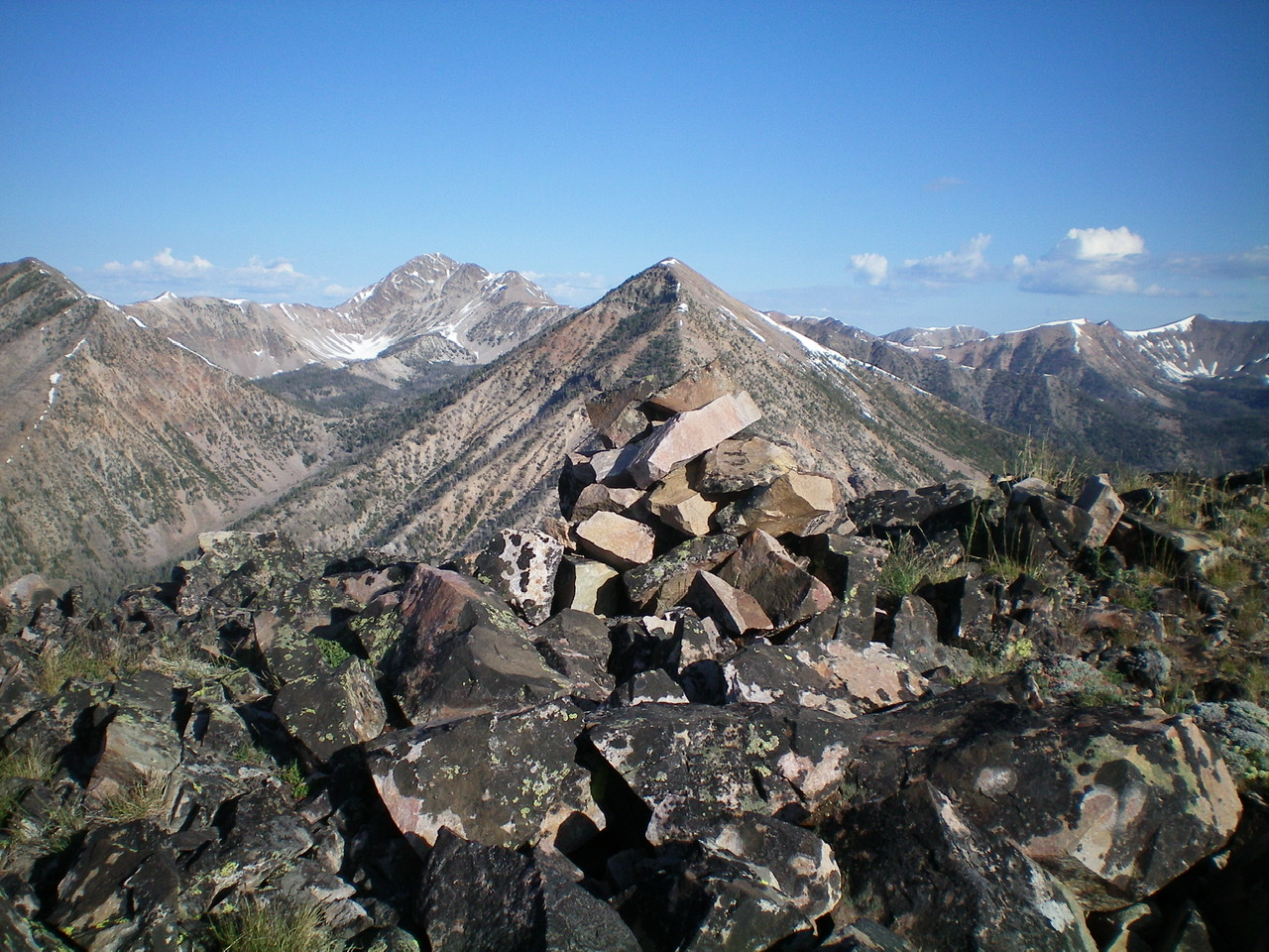 The summit cairn atop Peak 9785 with Peak 10263 in dead-center behind the cairn. Livingston Douglas Photo