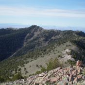 Bloom Benchmark is the high point just left of center, as viewed from the summit of Peak 9877. Livingston Douglas Photo