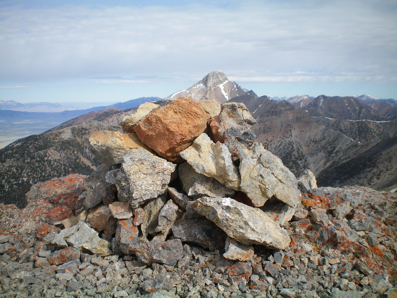 The summit cairn atop Peak 10681 with Bell Mountain in the distance. Livingston Douglas Photo