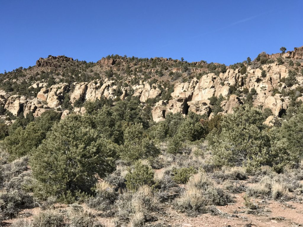 A wide angle view of the boulder cliffs.