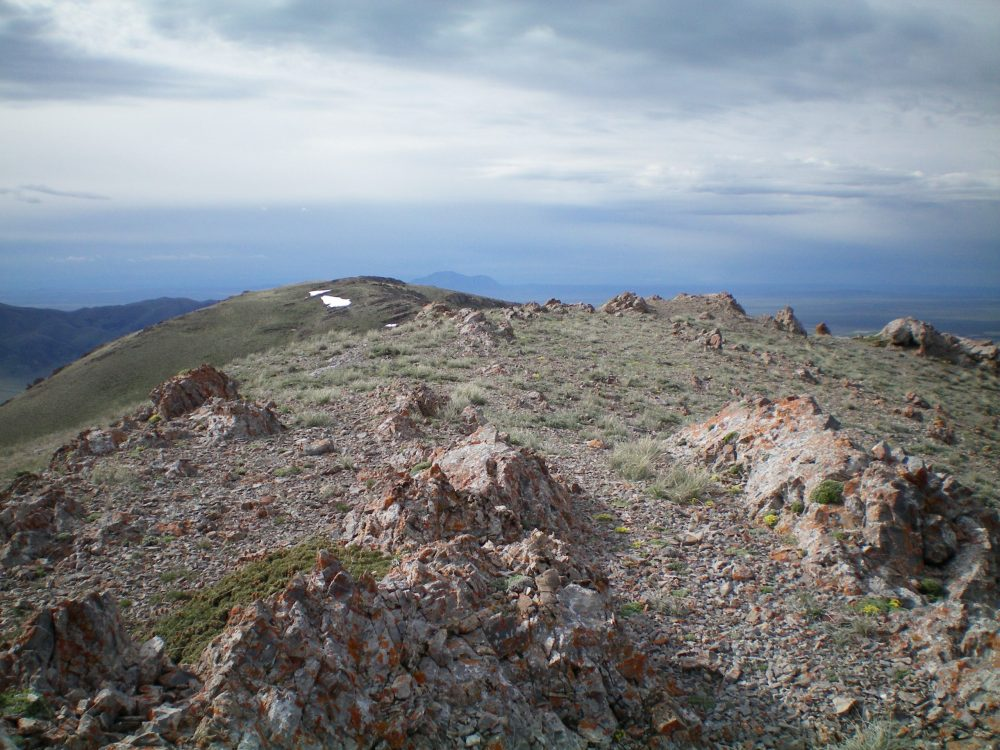 The summit rocks of Peak 8082, looking S toward Point 8070. Livingston Douglas Photo