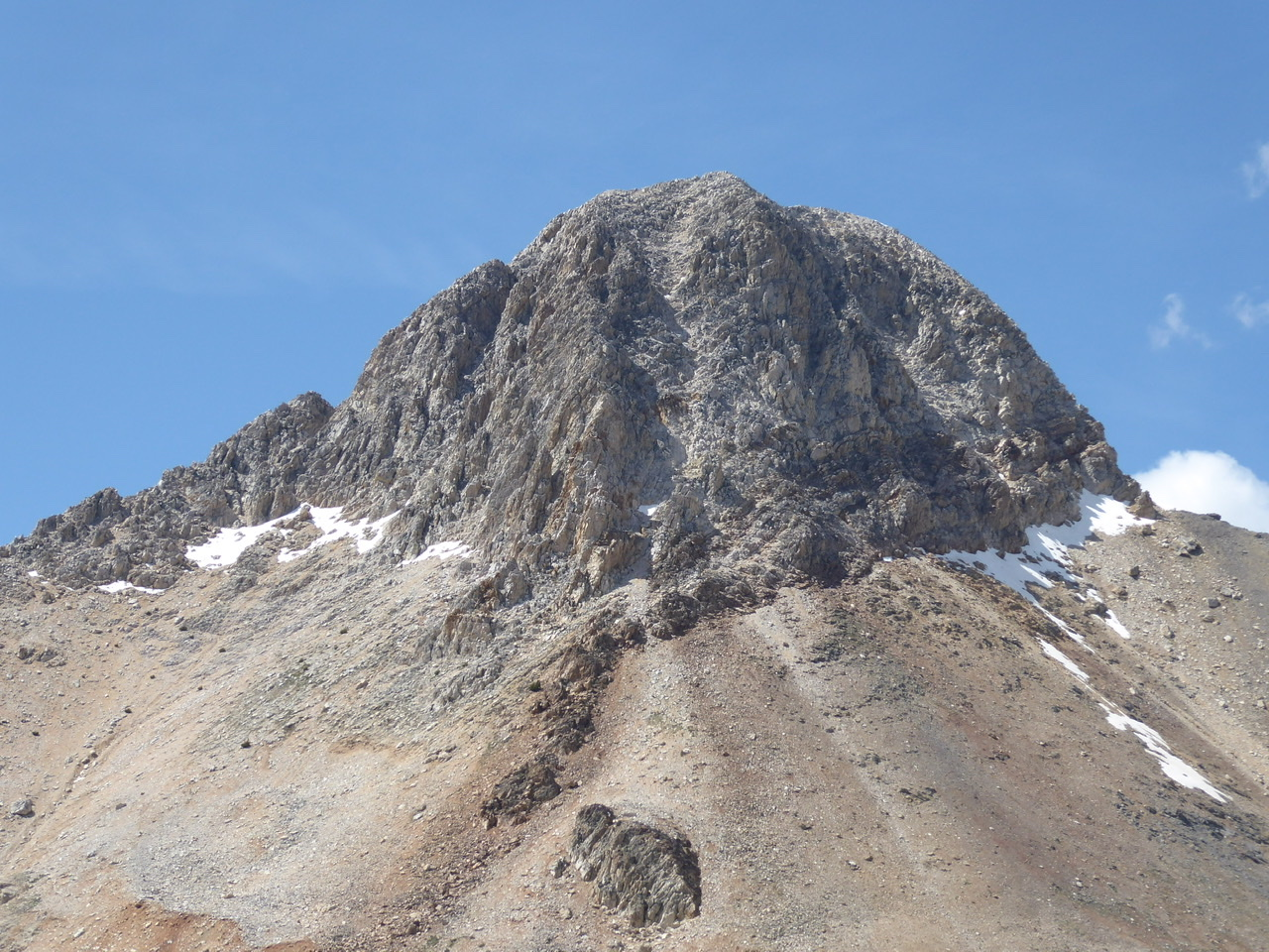 Bell Mountain viewed from the Clapper. The gully in the center of the face (just right of the south ridge) is the line used to ascend and descend this side of the peak. Steve Grantham Photo