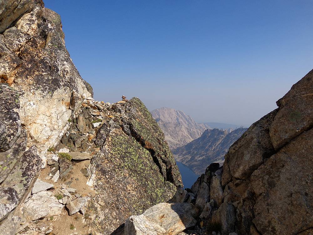 The cairn marks the spot where a ledge leads out onto the east face. Dave Pahlas Photo