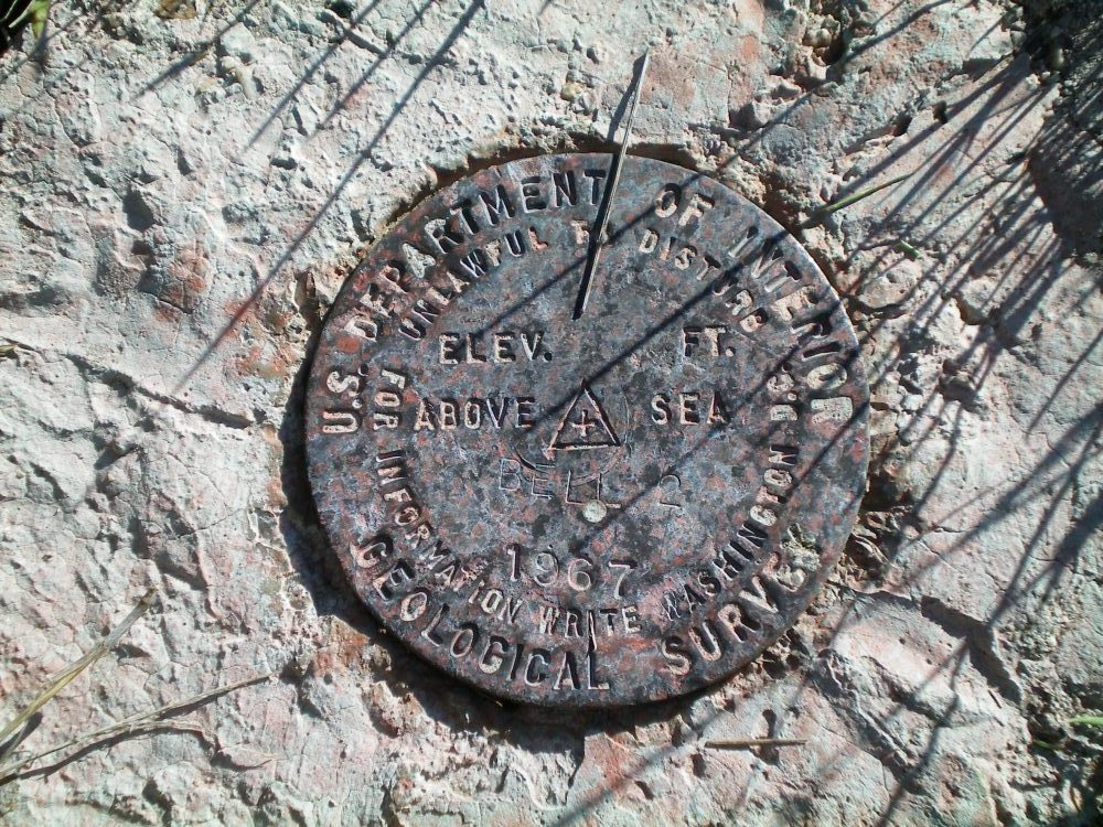 The USGS Benchmark atop Bell Mountain. Livingston Douglas Photo