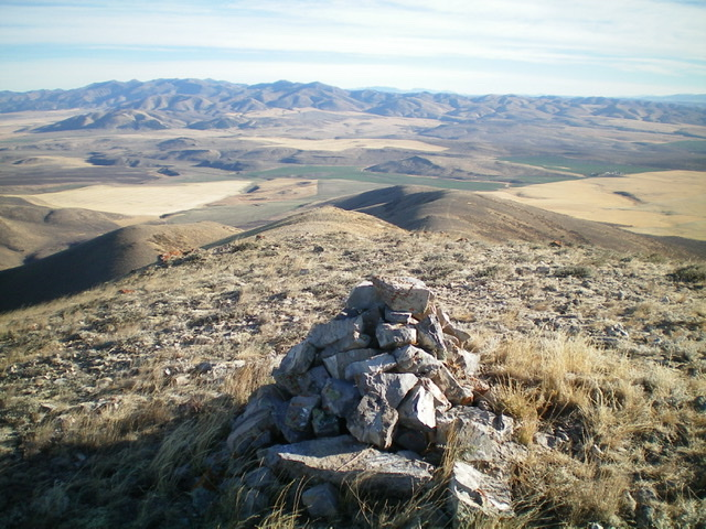 The large summit cairn atop Quaking Aspen Mountain, looking north. Livingston Douglas Photo