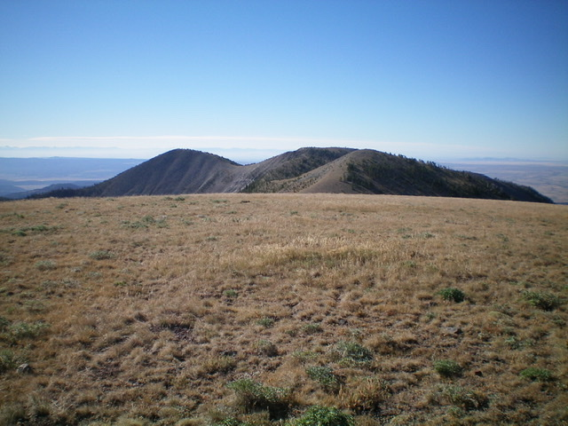 Slide Mountain (the hump left of center) as viewed from the south summit of Baldy Mountain. Notice the weaving, rolling ridge traverse required to get there. Livingston Douglas Photo