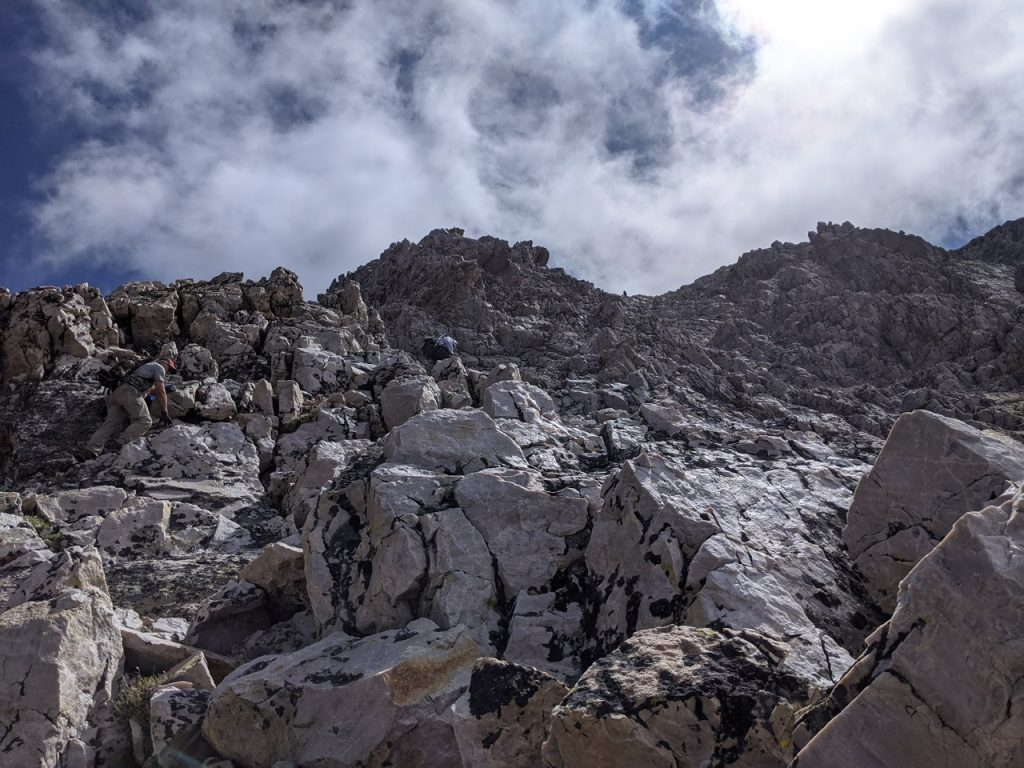 Climbing up the west face roughly 200 feet below the summit. Bill Manny Photo