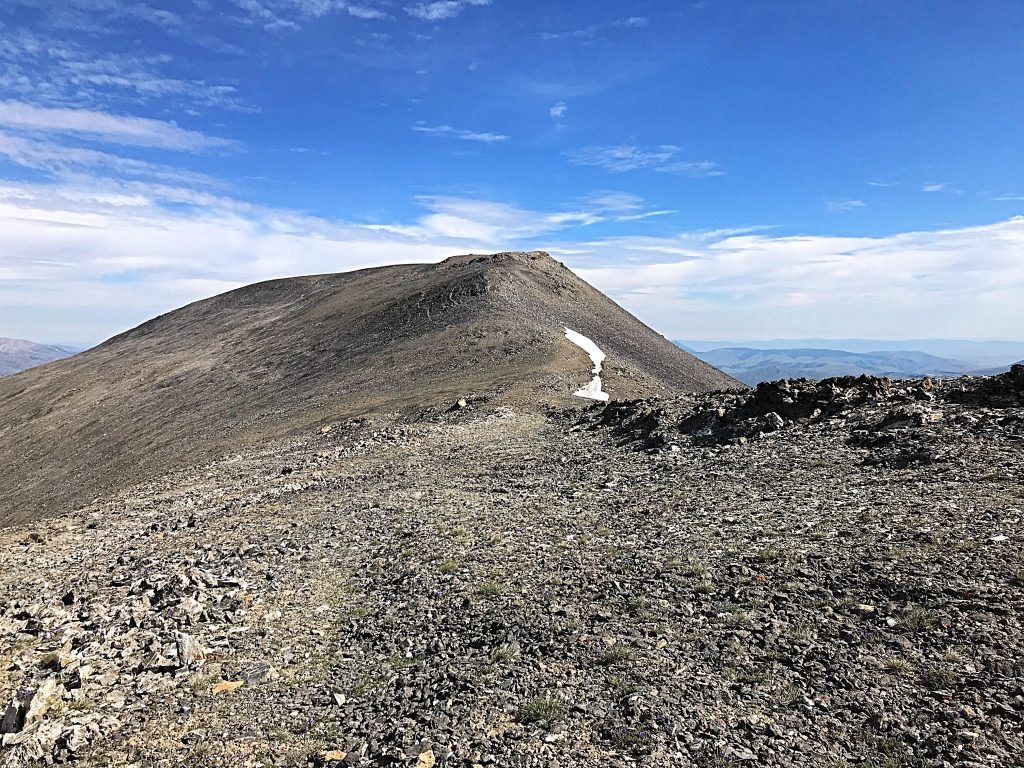 The summit of Scott Peak viewed from the top of the Tower Rib. Scott Peak's summit ridge is nearly a mile long. The southern end of the ridge encompasses Webber Peak and the Clark County High Point.