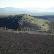 The East Face of Big Craters as viewed from the summit of Inferno Cone. The craters are on the far side of the hillside shown on the photo. The summit high point is just behind the trees, on the East Rim. Livingston Douglas Photo