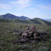 The summit cairn atop Peak 6326 with Pine Mountain in the distance (left) and Peak 6331 in the middle with its LONG Northeast Ridge. Livingston Douglas Photo
