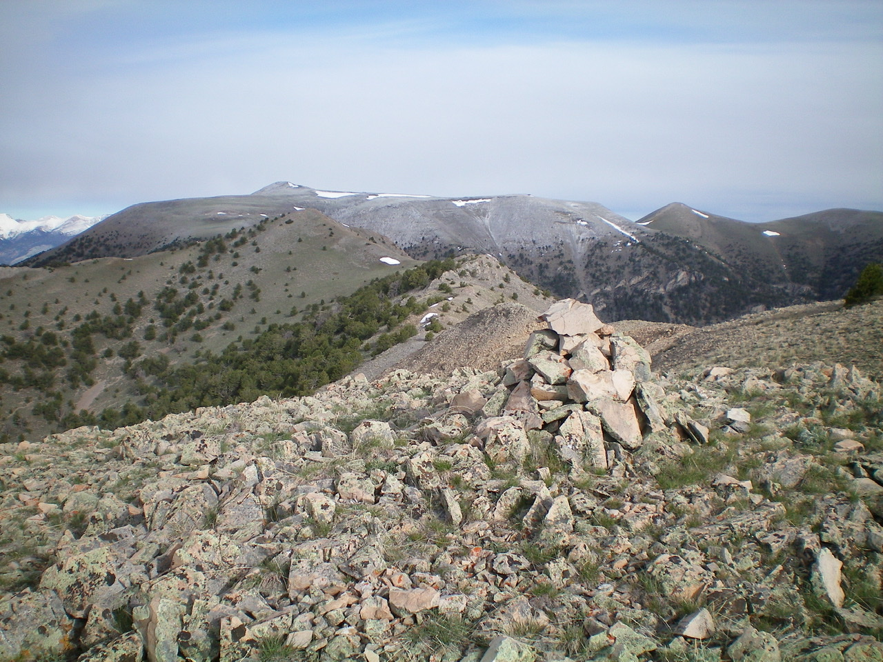 The summit cairn atop Gallagher Peak, looking west. Peak 9877 is the bare hump just left of center. Copper Mountain (10,303 feet) is behind it in the distance. Livingston Douglas Photo