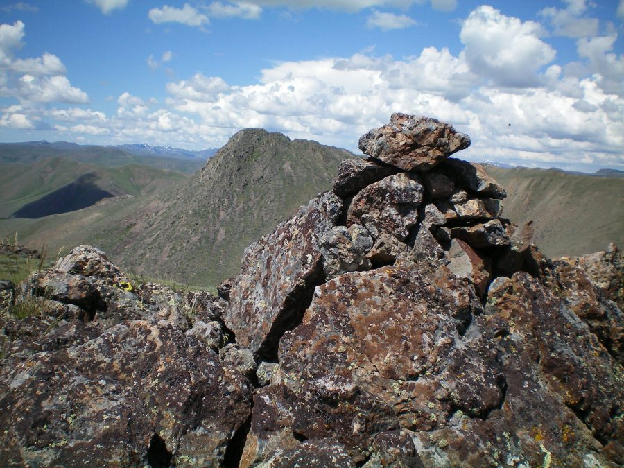 The summit cairn atop Peak 6541. Rugged Peak 6684 is in the background, just left of the cairn. Livingston Douglas Photo