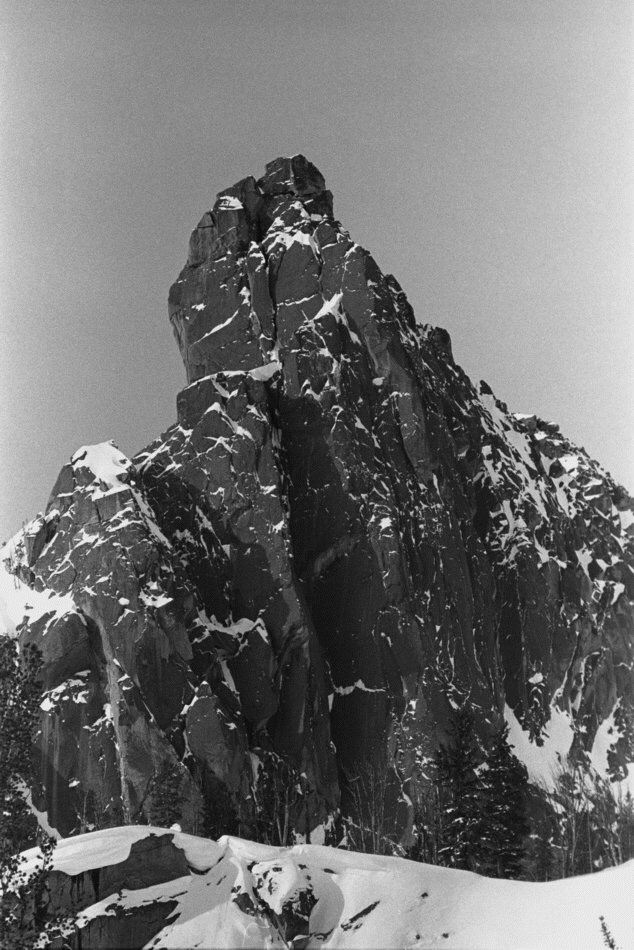 """4. The North Face of the Finger, showing the """"Open Book"""" route in deep shadows, not a nice climb in winter. It was attempted repeatedly before selecting an alternate plan."""