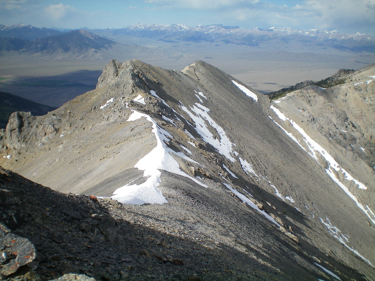 A look back at the Southwest Ridge and Southwest Summit of Medusa, from the true summit. Notice the extensive ridge snow still lingering on the Southwest Ridge in early July. Livingston Douglas Photo