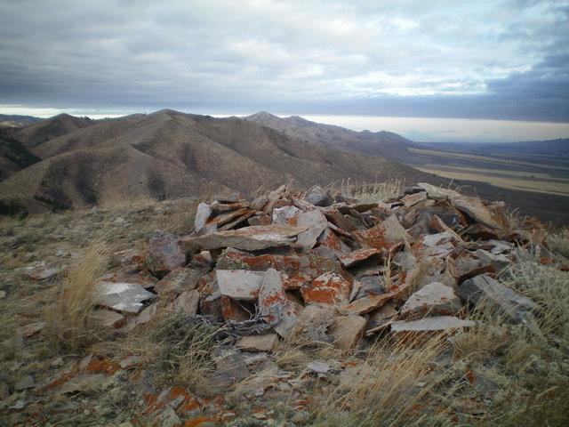 The flattened summit cairn atop Peak 6795, looking north. Livingston Douglas Photo