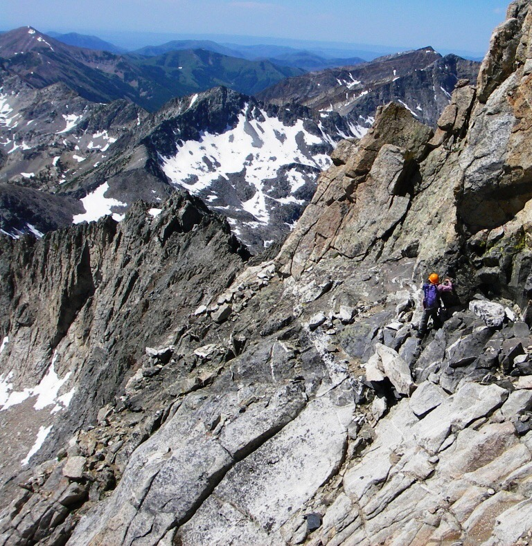 Returning on the black dike traverse. Just around the corner we got out the rope again protect our to climb back down to the ramp/ledge. Judi Steciak Photo