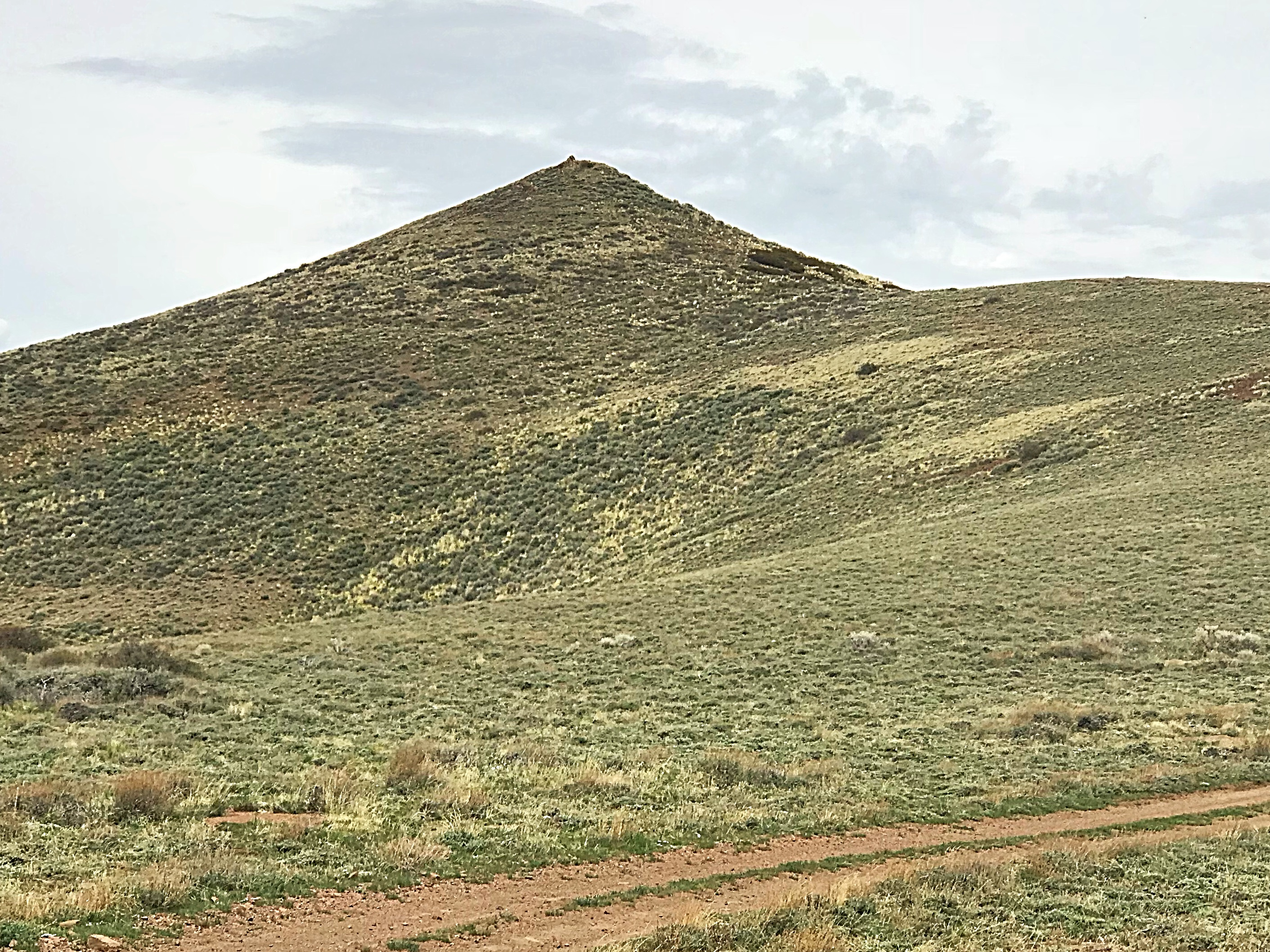 The summit cone of East Twin Peak. The 4WD road ends on the shoulder on the cone's right side.